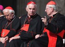 католици