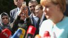 Ангела Меркел с бежанци