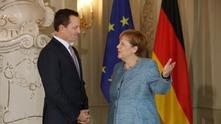 Рик Гренъл и Ангела Меркел