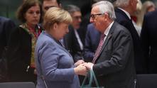 ангела меркел и жан-клод юнкер