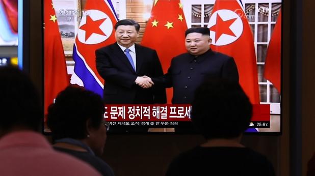 Си Дзинпин и Ким Чен-ун